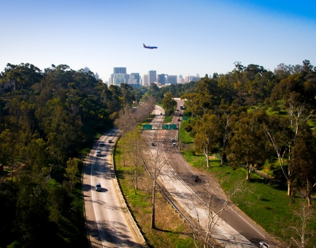 Airplane-over-Downtown-San-Diego,-CA