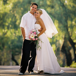 Bride and Groom in Tree Lined Road